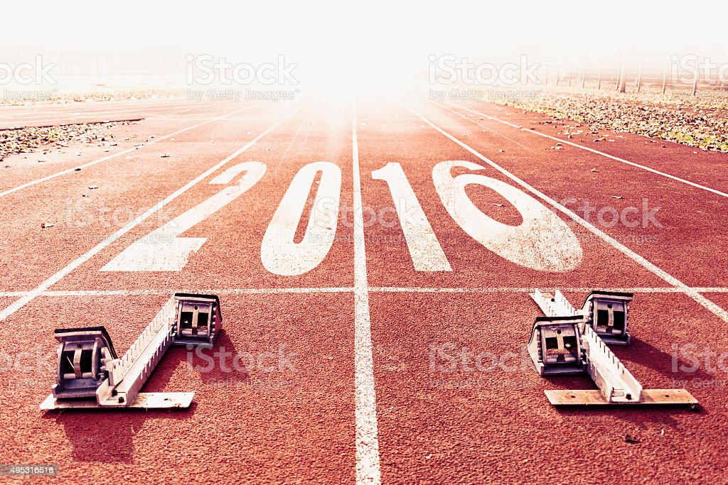 new year 2016 warm look numbers painted on lane stock photo