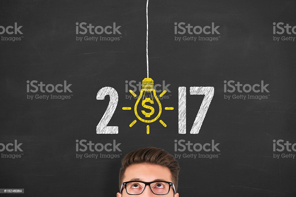 New Year 2017 Finance Concept on Chalkboard Background stock photo