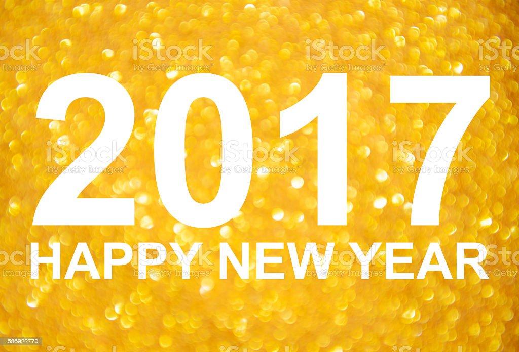 New Year 2017 golden glitter background stock photo