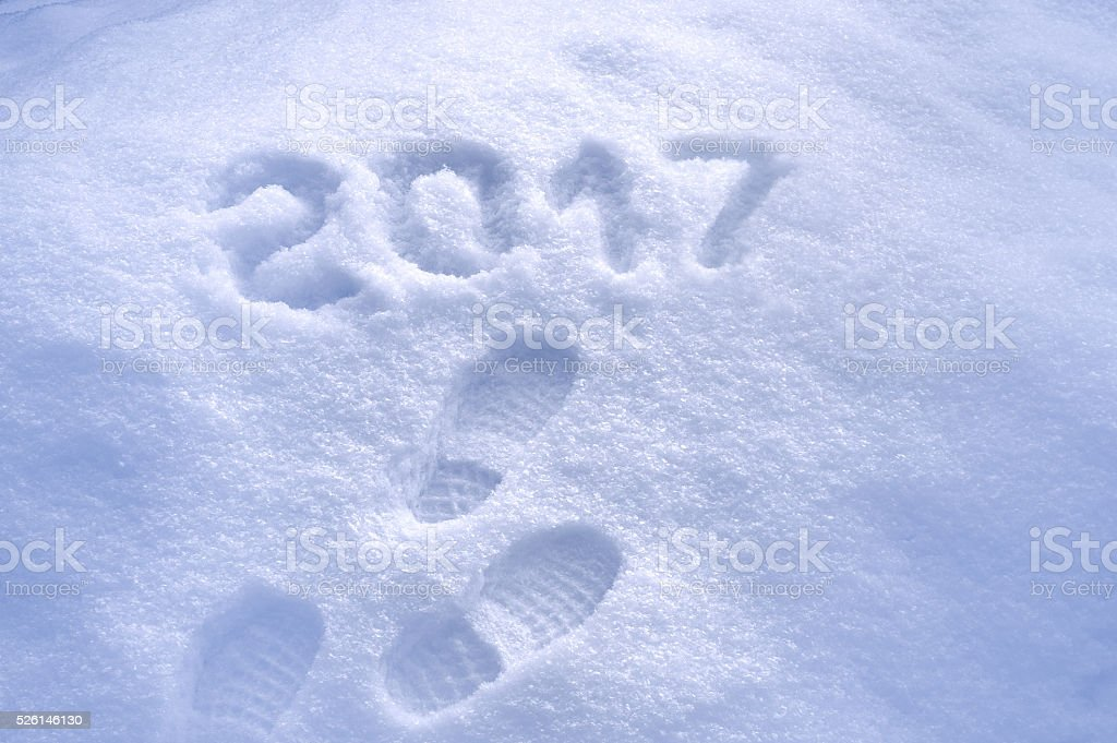 New Year 2017 greeting, footprints in snow, 2017 greeting stock photo