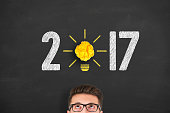 New Year 2017 Idea Concept Light Bulb Crumpled Paper