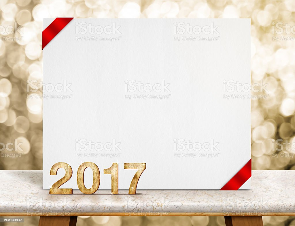 new year 2017 number and white card paper with ribbon stock photo