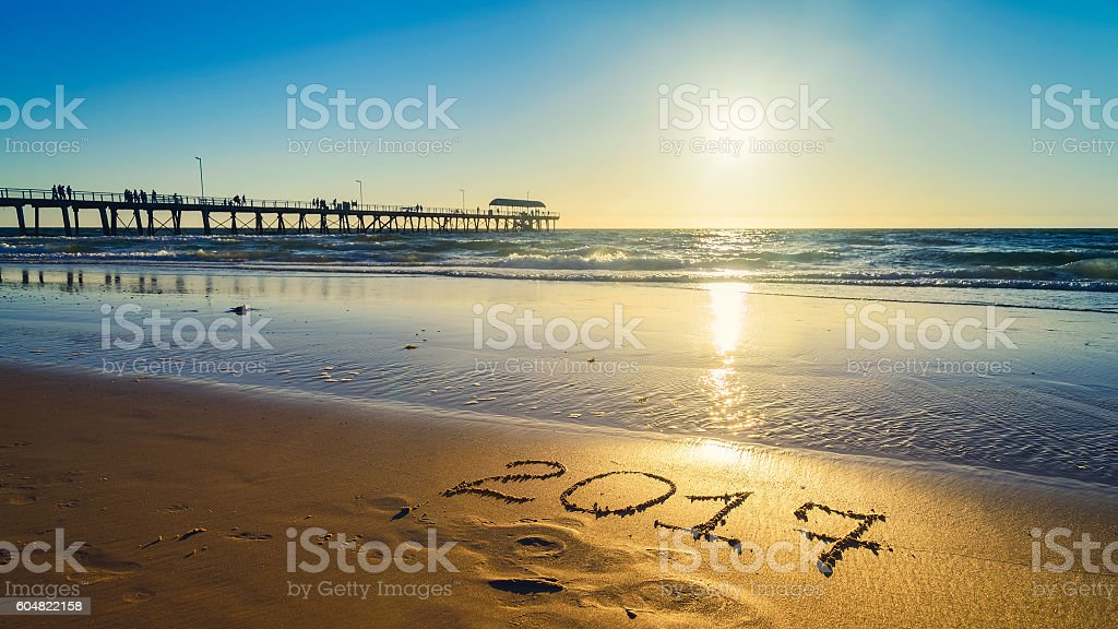New Year 2017 number on sand stock photo