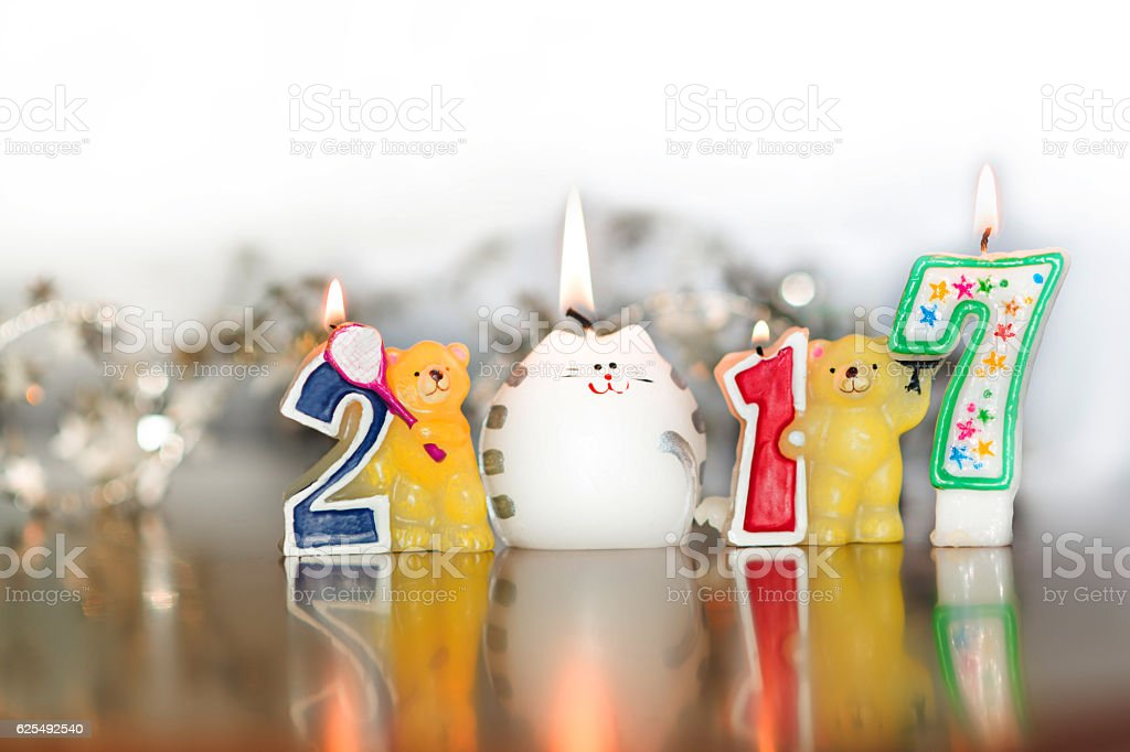 New Year 2017. numbers, background, picture, conflagrant candle. stock photo