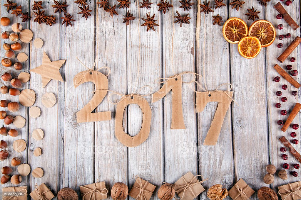 New Year 2017 on wooden background stock photo