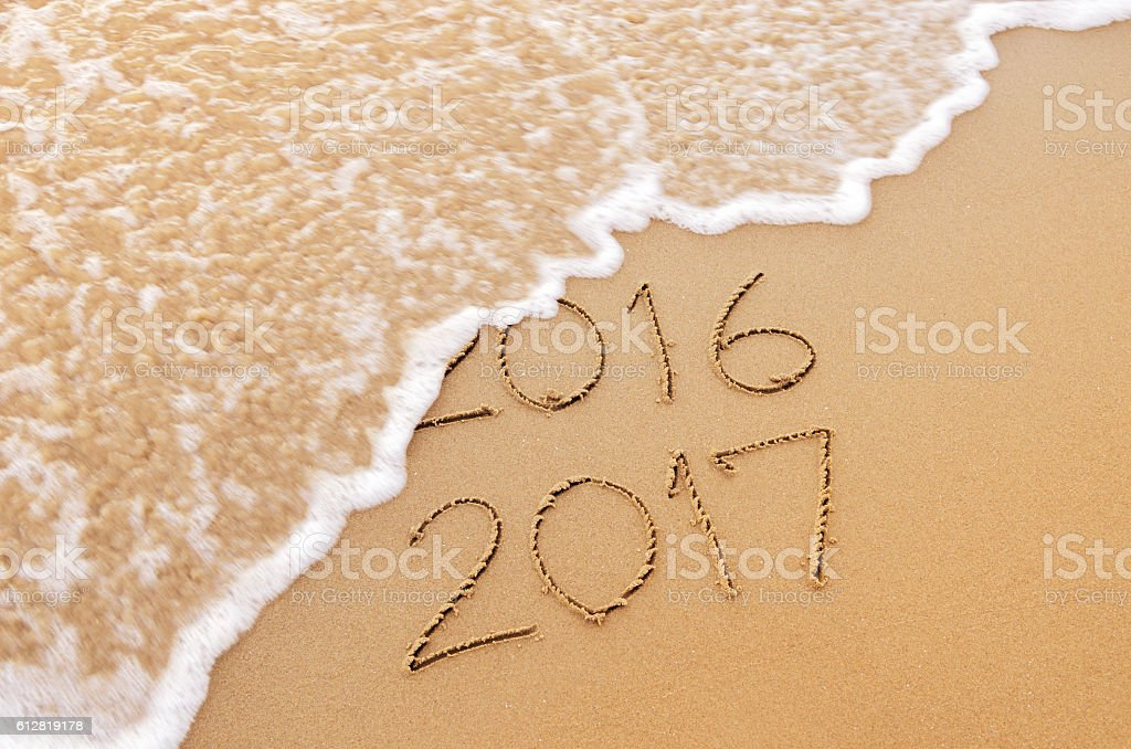 New Year 2017 replace 2016 on sea stock photo
