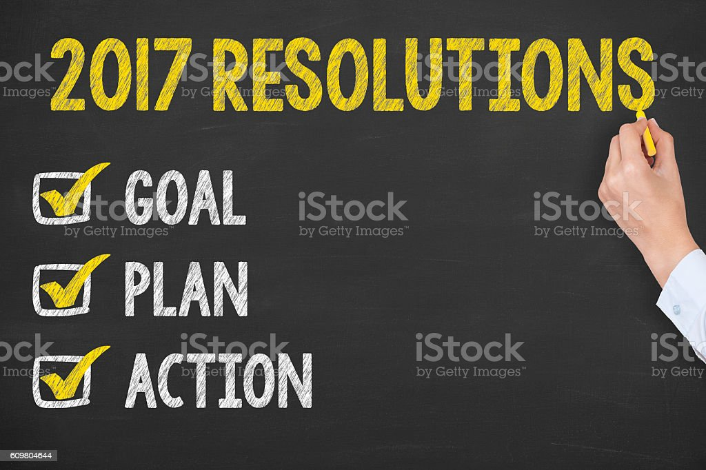 New Year 2017 Resolution on Chalkboard Background stock photo