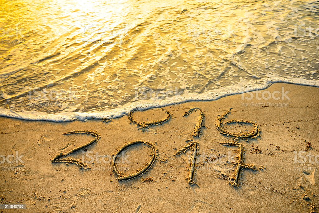 New Year 2017 written in the sand stock photo