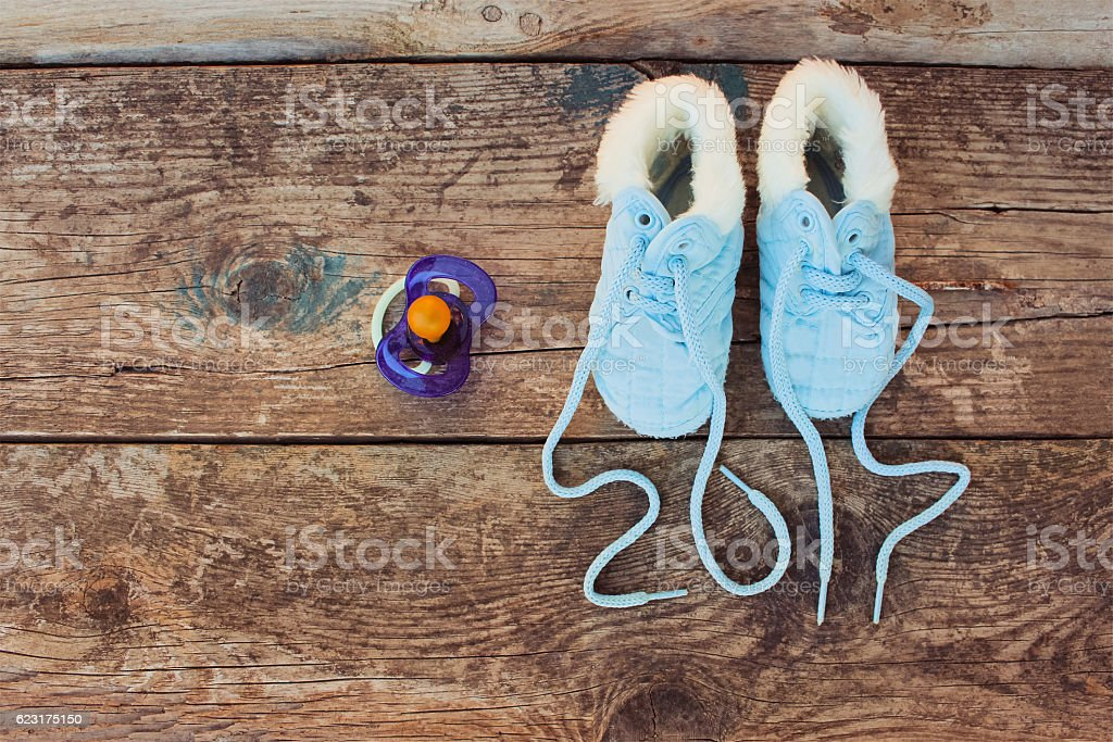 New year 2017 written laces of children's shoes and pacifier stock photo