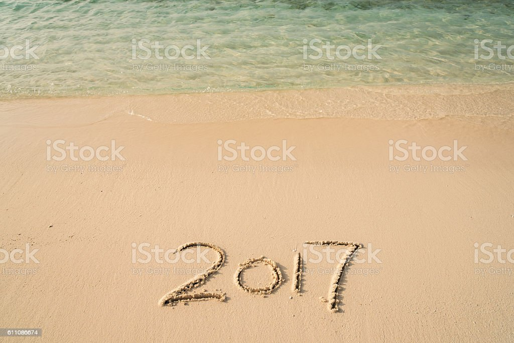 New Year 2017 written on sandy beach stock photo