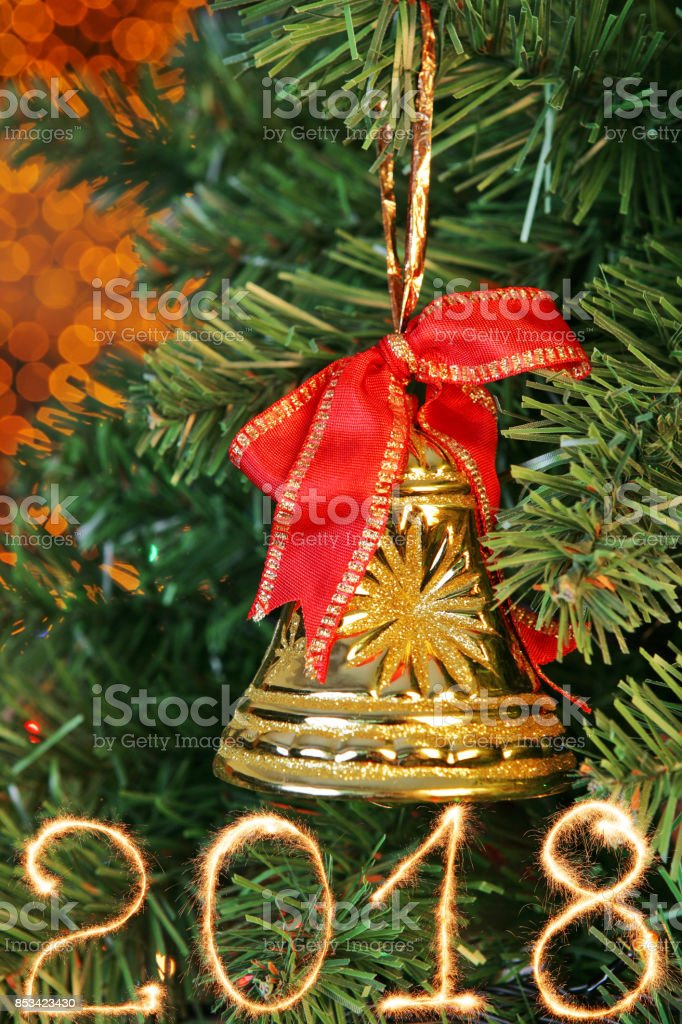 New Year 2018 sign made of sparkler trace over the Christmas tree stock photo
