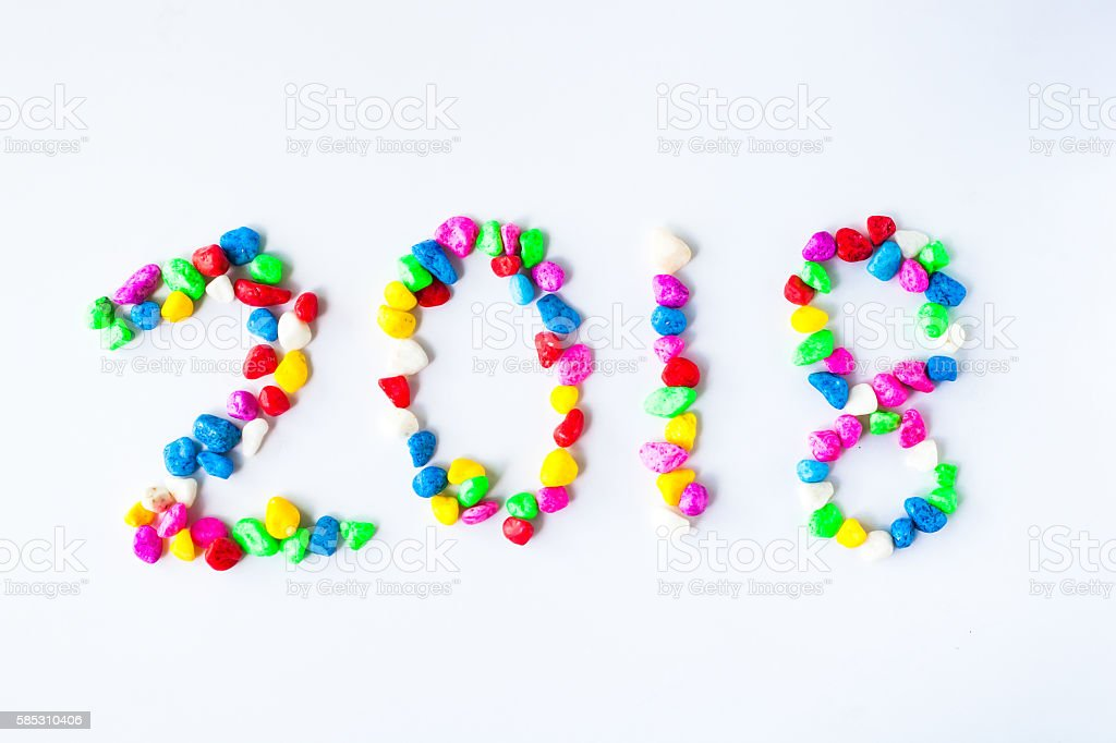 New year 2018 with colorful stone on white background. stock photo