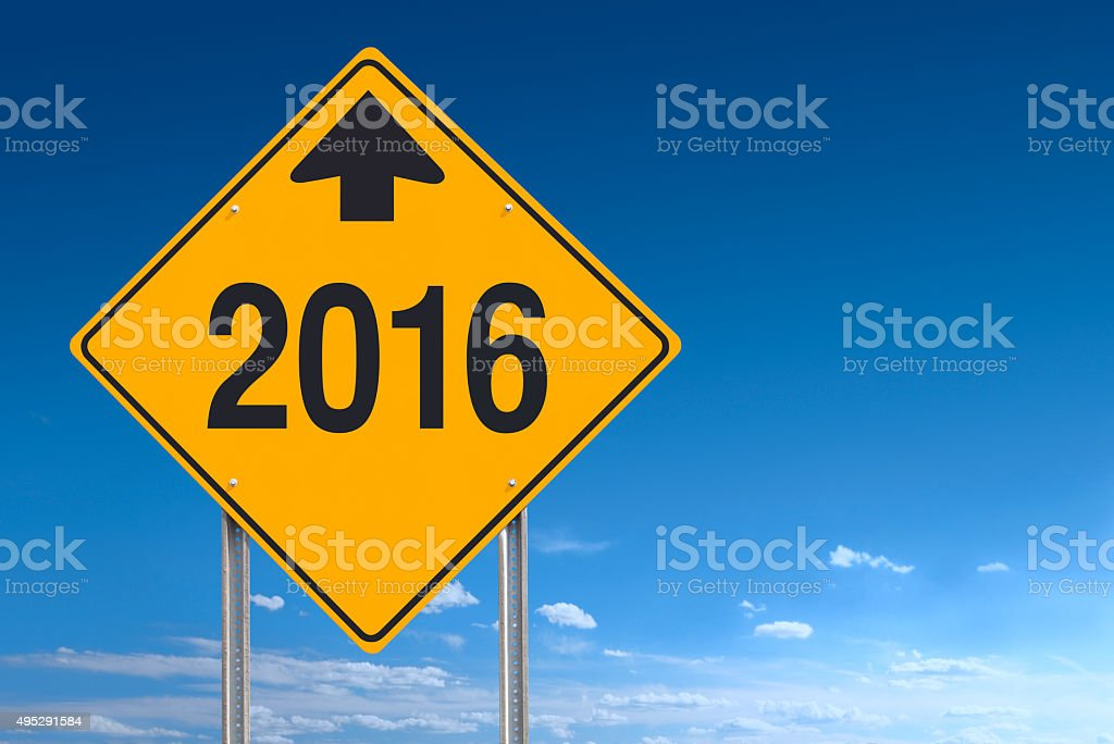 New Year Ahead 2016 Sign Post Over Clear Sky Background stock photo