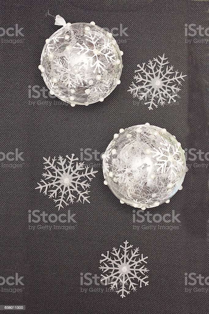 New Year and Christmas arrangement of fir-tree balls and snowflakes. stock photo