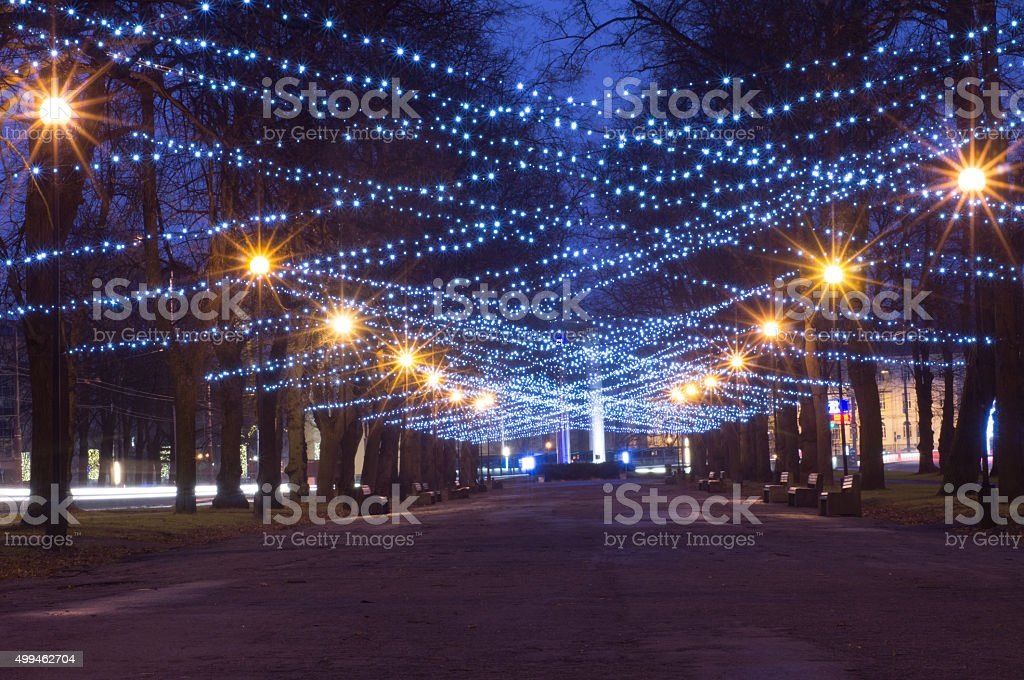 New Year and Christmas festoon illumination on city alley stock photo