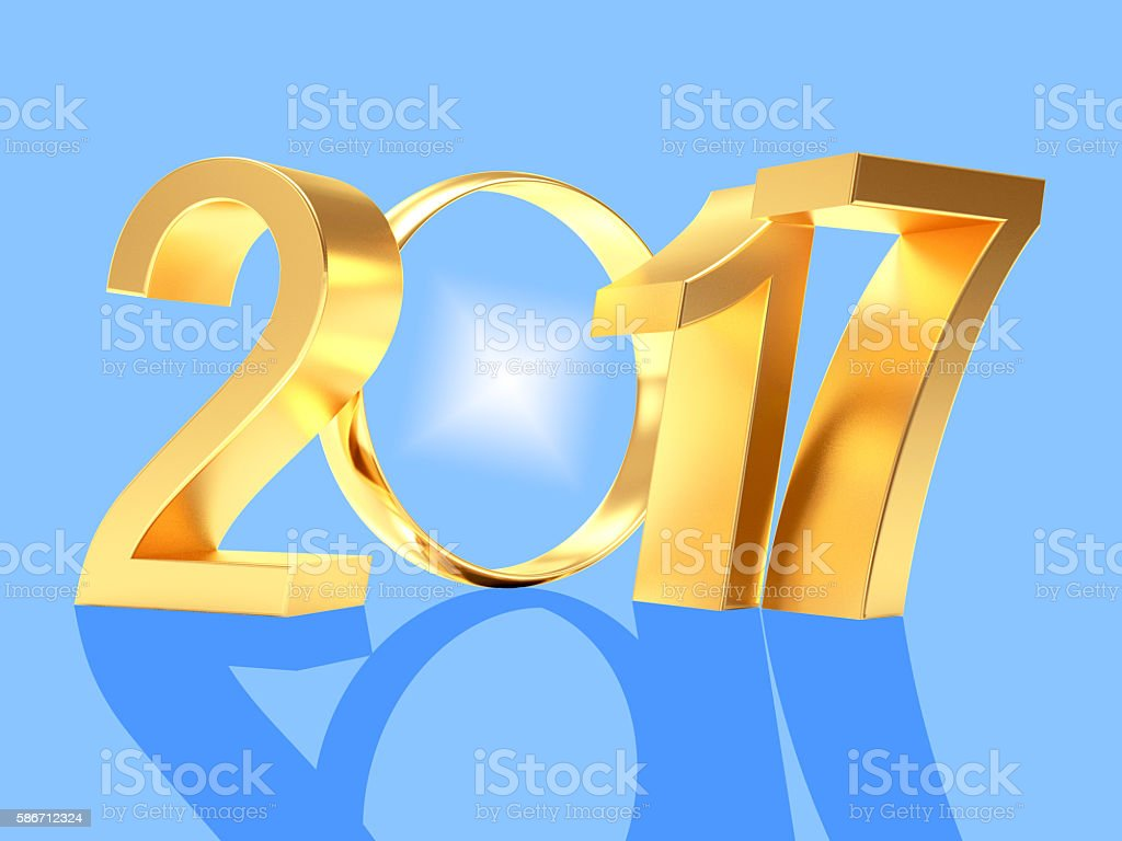 2017 New Year and golden wedding ring on blue stock photo
