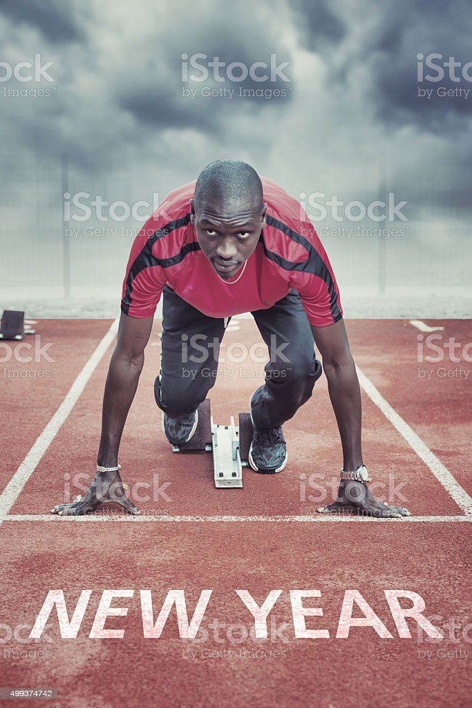 New Year. Athlete in the starting blocks stock photo
