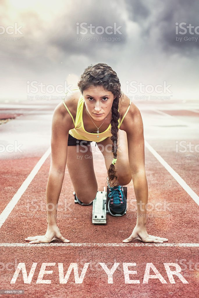 New Year. Athlete in the starting blocks stock photo