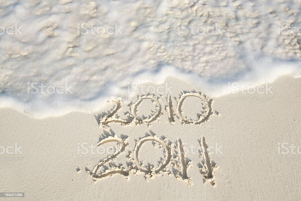New Year Beach Vacation 2010 to 2011 Written on Sand royalty-free stock photo