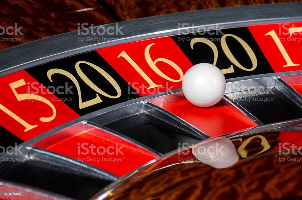 2016 New Year casino roulette wheel red sector sixteen 16 stock photo