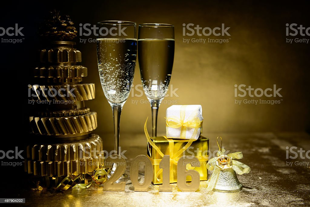 New Year composition with champagne and gifts on gold background stock photo