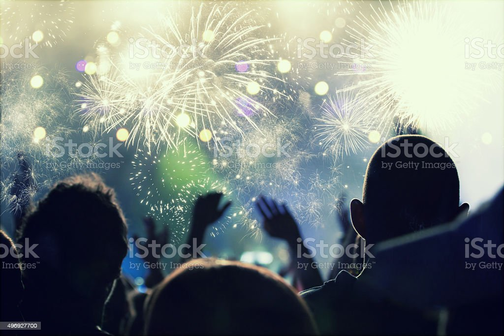 Cheering crowd and fireworks at New Year\'s Eve - people celbrating on...