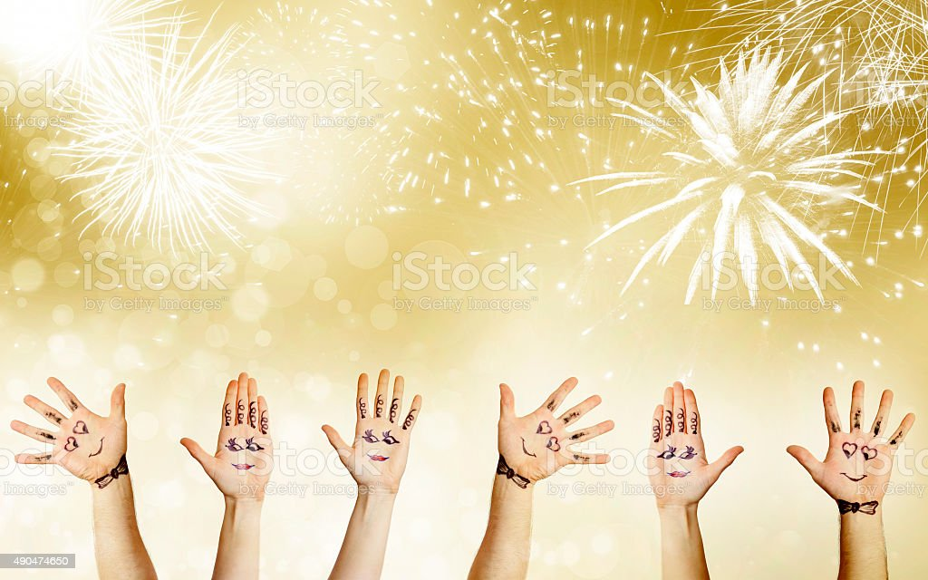New Year concept with painted hand celebrating stock photo