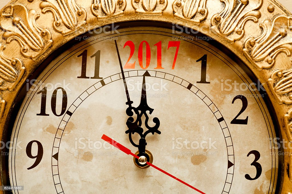 New year countdown on a wall clock stock photo
