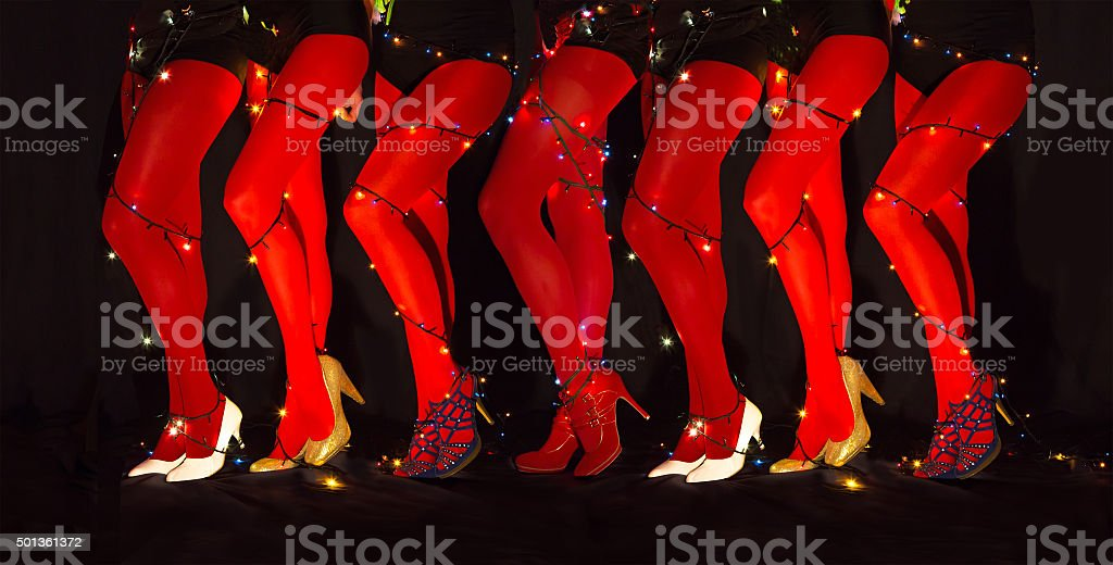New year dancing composition of seducing women legs garland illumination stock photo