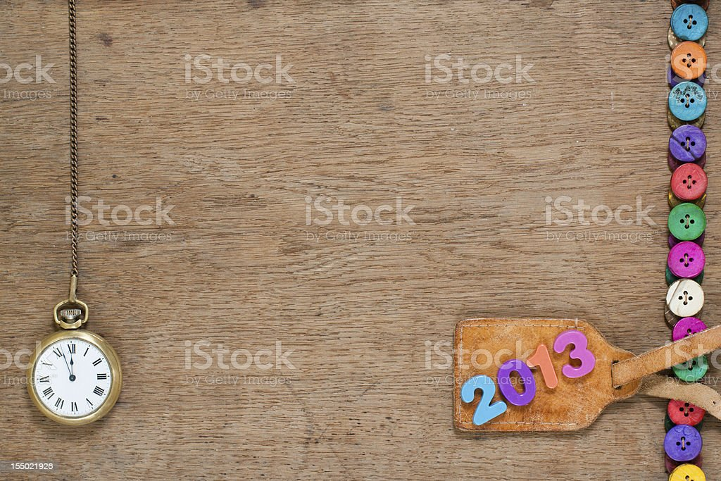 New Year date, pocket watch, colorful buttons on wood royalty-free stock photo
