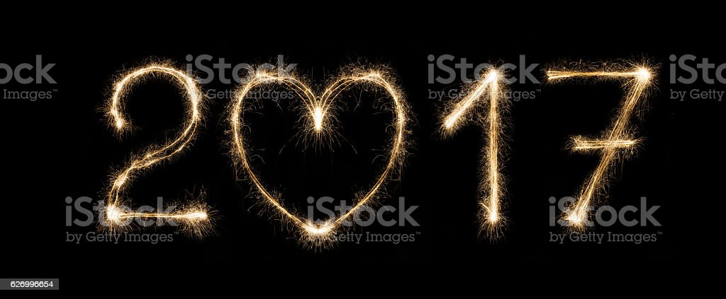 New year date, sparkler numbers on black background stock photo