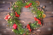 New Year Decoration with Wreath of Pine Branches and Rowan