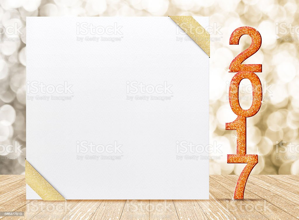 2017 New year glitter number and card with gold ribbon stock photo