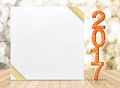 2017 New year glitter number and card with gold ribbon