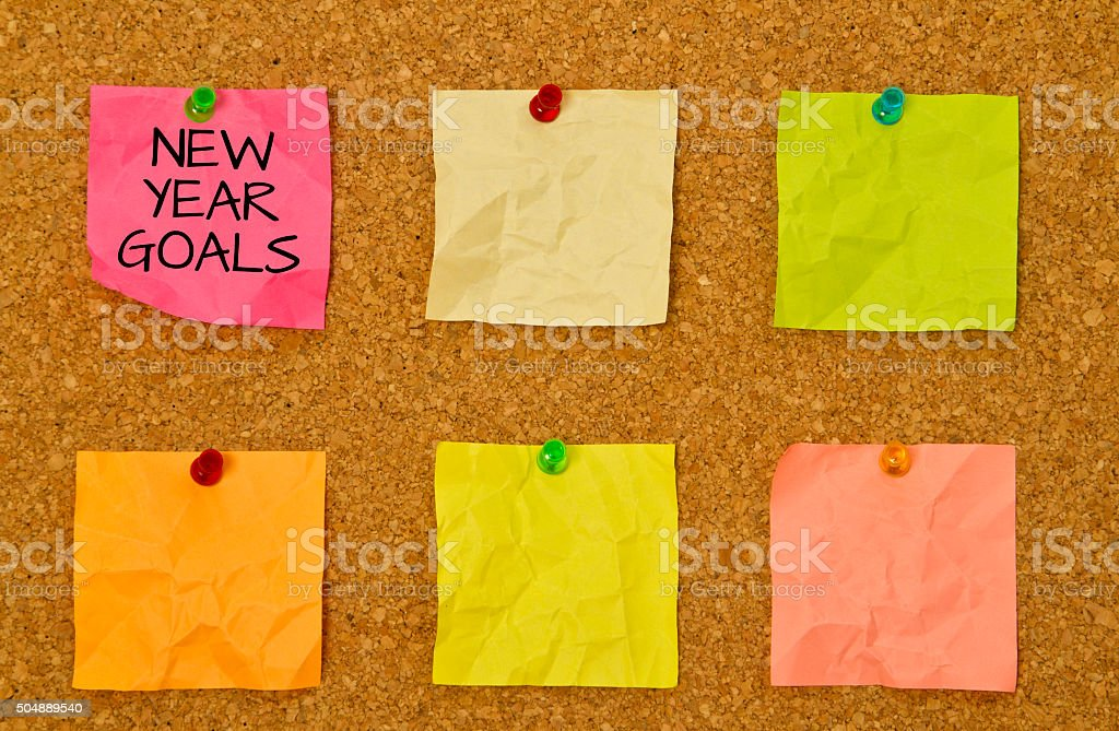 New Year goals on sticky notes against burlap stock photo
