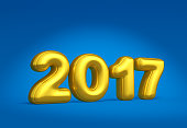 New Year golden numbers on blue background. 2017 date