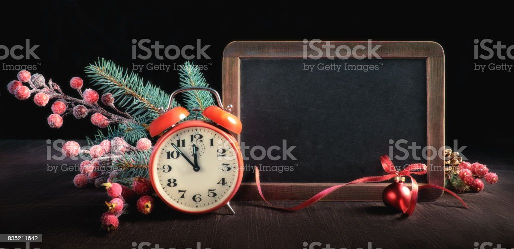 New Year greeting card design with decorated blackboard and clock stock photo