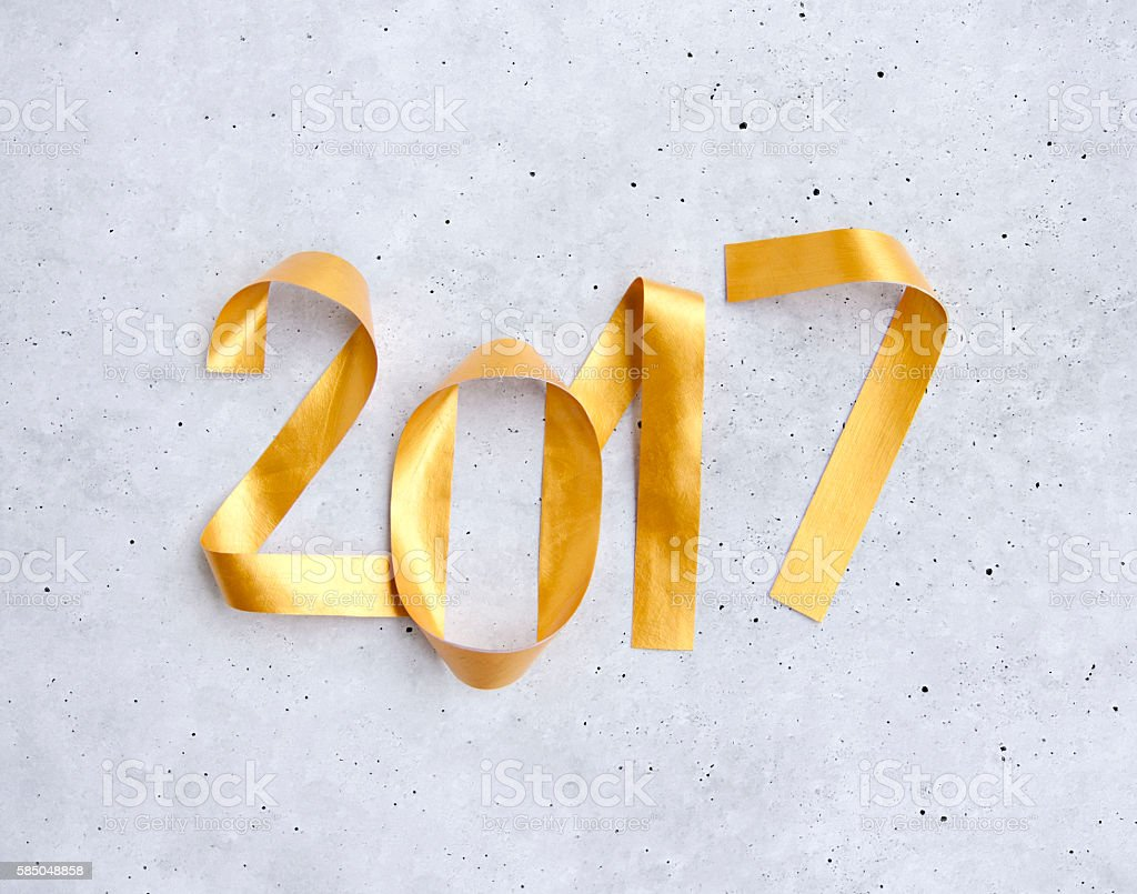 New Year greeting card with glowing golden paper numbers 2017 stock photo