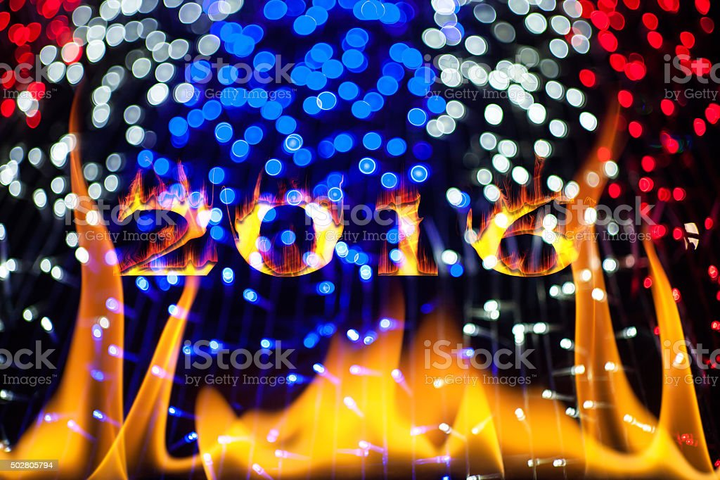 2016 New Year in flames on bokeh. stock photo