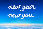 New year new your cloud text on blue sky