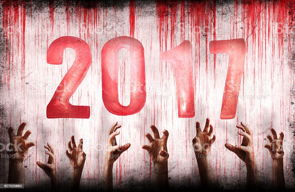 New Year numbers 2017 with bloody wall and hands stock photo