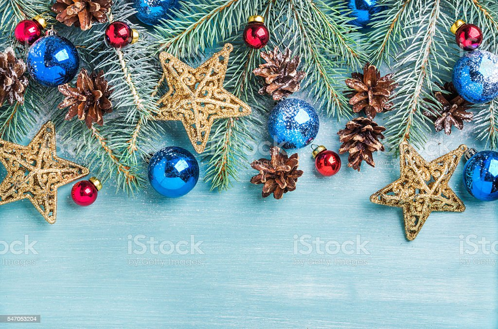 New Year or Christmas background: fir branches, colorful glass balls stock photo