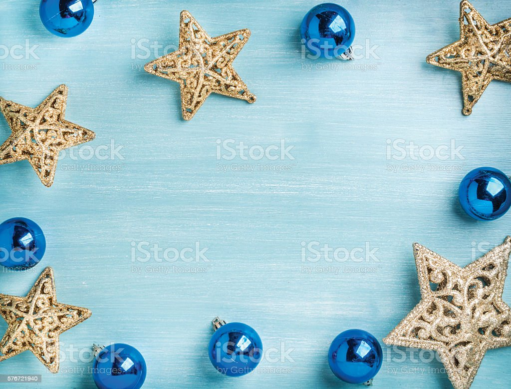 New Year or Christmas background: golden stars and blue glass stock photo