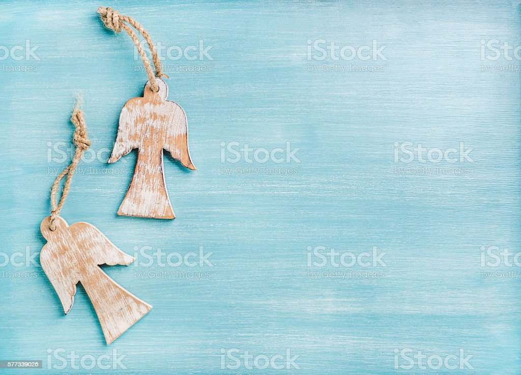 New Year or Christmas background: two wooden angels over blue stock photo