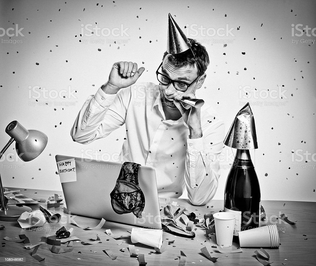 New Year Party, Birthday, hungover man behind laptop, office, retro stock photo