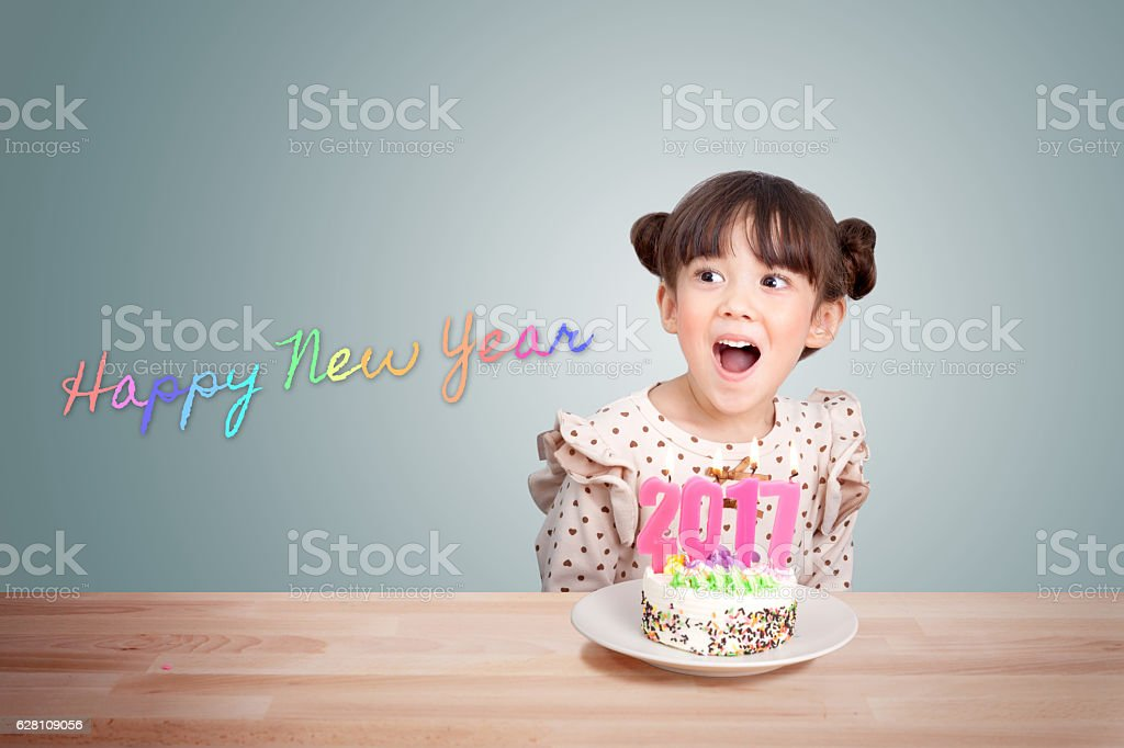 new year party with cake and candle 2017 stock photo