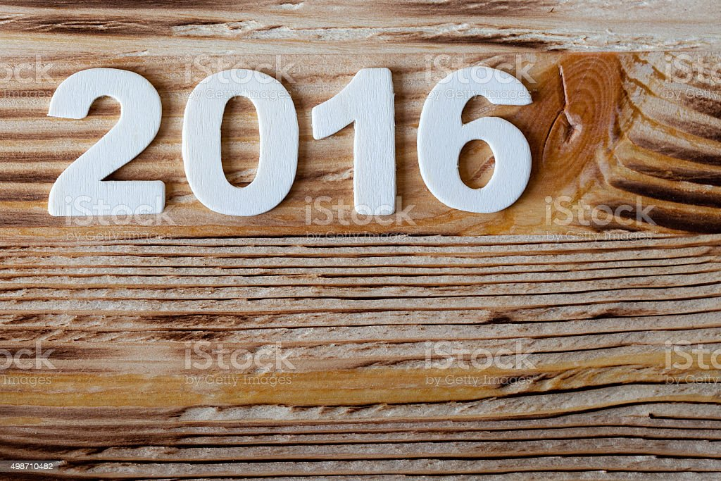 New year postcard frame. date wood texture number on wooden stock photo