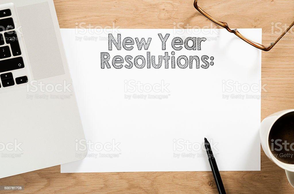 new year resolution written paper stock photo