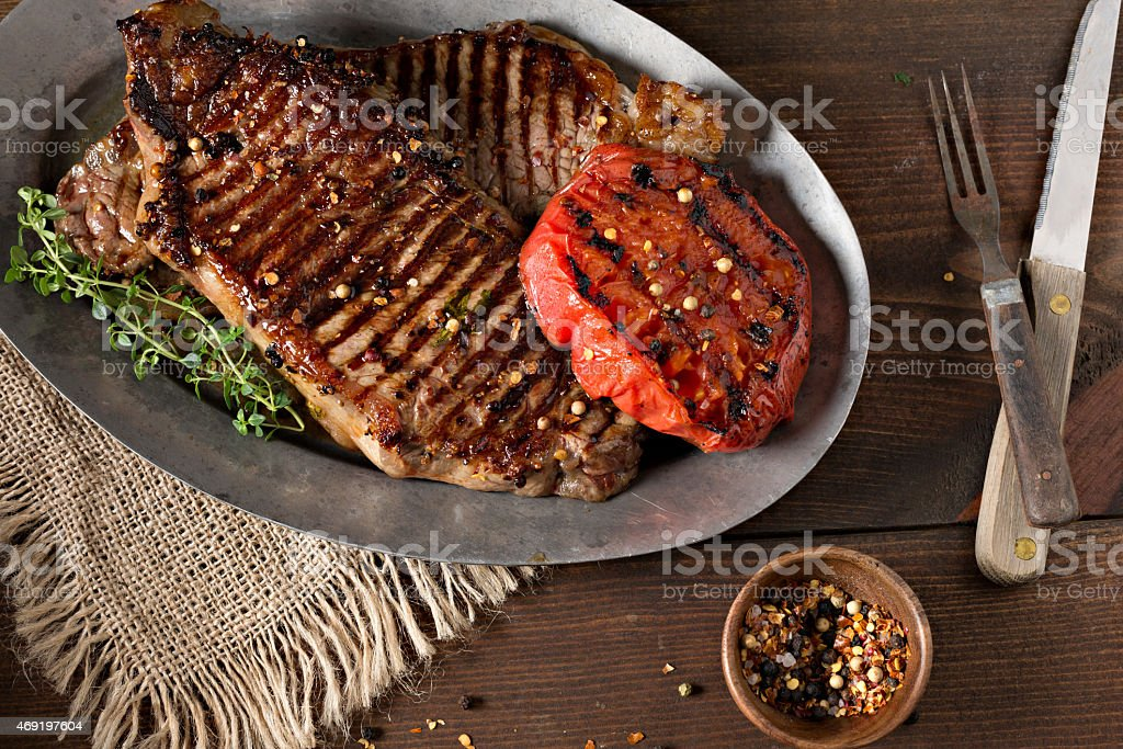 New Year Strip Steaks On A Metal Platter stock photo