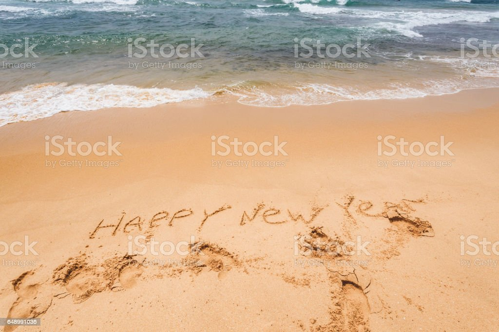 New Year text on the sea beach. stock photo